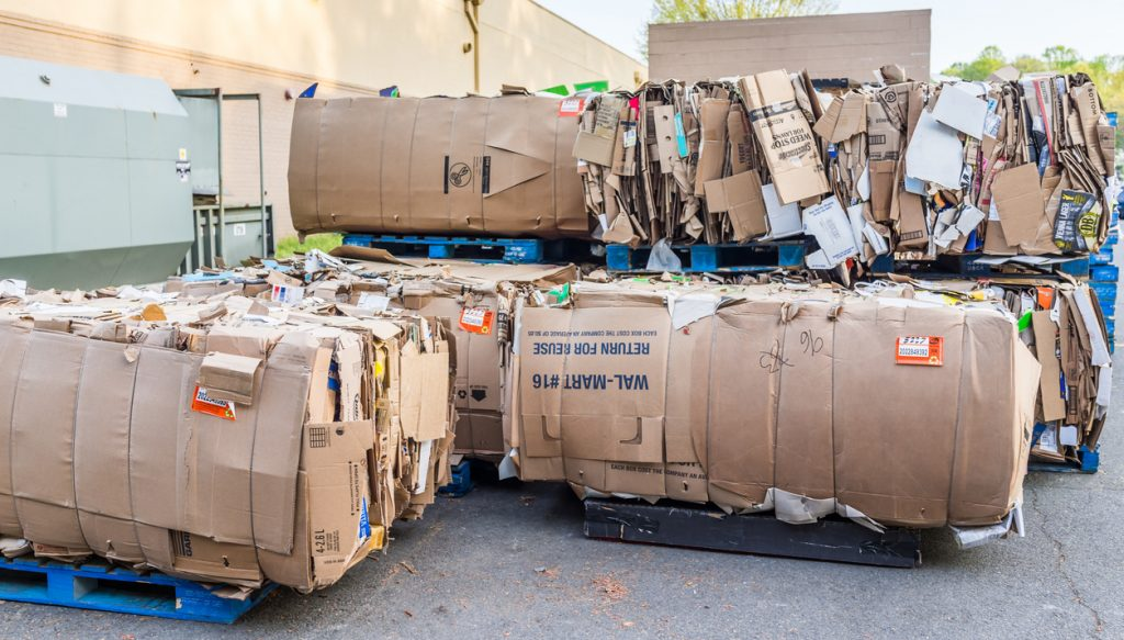 Piles of compacted cardboard and trash